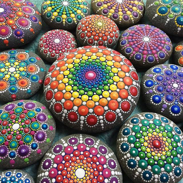 Artist finds beautiful beach stones and turns them into - Painting rocks for garden what kind of paint ...