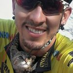 Cyclist Stops To Rescue Helpless Kitten, And The Cat Can't Stop Thanking Him With Kisses